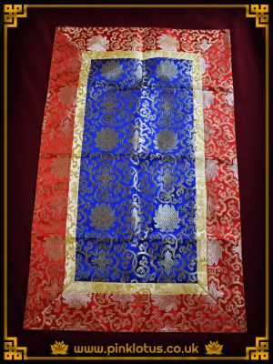 A nice silk like Tibetan Buddhist Altar cloth made from silk like Thangka brocade. The cloth is Blue with cream and red border and has a nice maroon lining.